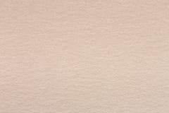 Sluit omhoog van lichte beige document textuur Royalty-vrije Stock Fotografie