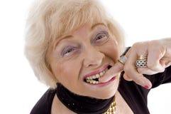 Sluit omhoog van oude vrouw die vinger in haar mond houdt Royalty-vrije Stock Fotografie