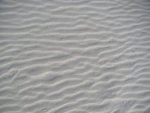 Sluit omhoog van patronen in het zand Royalty-vrije Stock Fotografie