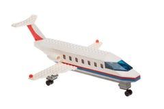Sluit omhoog van plastic stuk speelgoed geïsoleerd passagiersvliegtuig, Royalty-vrije Stock Afbeeldingen