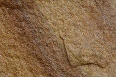 Sluit omhoog van Steenoppervlakte met detail van bruin rots en zand Royalty-vrije Stock Foto's