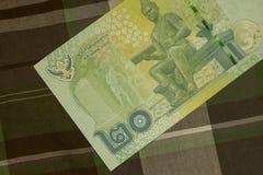 Sluit omhoog van Thais bankbiljet Thais bad met het beeld van Thaise Koning Thais bankbiljet van Thais Baht 20 op Groene Schotse  Stock Foto