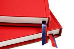 Sluit omhoog van twee rode dagboeken Stock Fotografie