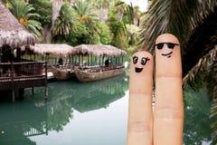 Sluit omhoog van twee vingers met smileygezichten Stock Fotografie