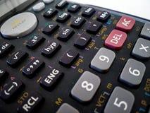 sluit omhoog van wetenschappelijke die calculator met witte achtergrond wordt geïsoleerd royalty-vrije stock fotografie