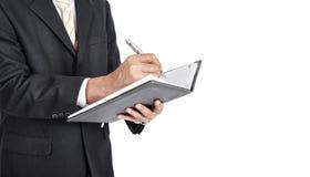 Sluit omhoog van zakenman die een nota met witte backgound schrijven Royalty-vrije Stock Foto