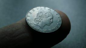 Sluit omhoog van zeer oude muntstukken stock footage