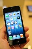Sluit omhoog van zwarte iPhone 5 Stock Foto