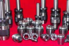Sluit omhoog velen grootte van malenklem en ring met component van cnc machine voor hoge precisie en nauwkeurigheids productie vo royalty-vrije stock afbeelding