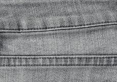Sluit omhoog Zwart Denim Jean Texture met Naden Royalty-vrije Stock Afbeelding