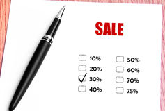 Sluit omhoog Zwart Pen And Checked 30% Voorzien Rate At Sale Promotion Stock Afbeelding