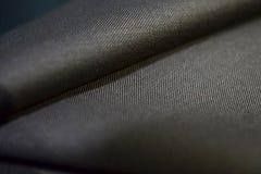 Sluit textuur omhoog bruine stof van kostuum Royalty-vrije Stock Afbeeldingen
