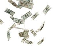 Sluit van ons omhoog dollargeld die over wit vliegen Royalty-vrije Stock Afbeeldingen