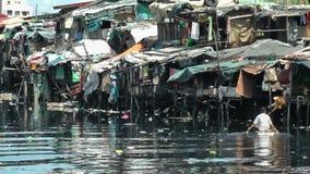 Slum along a canal in ghetto Tondo in Manila-Philippines stock video