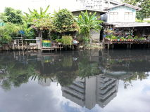 Slum along a dirty canal Stock Photo