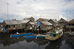 Slum area. Near Paotere harbor, the old port of Makassar royalty free stock image