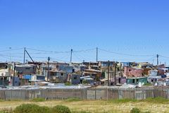 Township behind fence, Cape Town, South Africa Stock Images