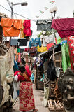 Slum area of India. Woman drying washed clothes in poor slum area of Kolkata, India Stock Photography