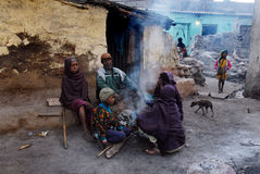 Slum Area. Lifestyle in the Indian slums which is a populated area that consists of poor housing and is characterized as a poverty place with people living in it stock photos