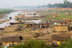 Slum area in Myanmar. Slum village near the river in the Mandalay city in Myanmar (Burma royalty free stock image