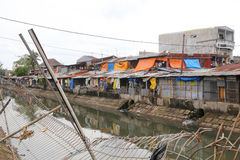 Slum area. A riverside slum area in Makassar, Indonesia stock photography