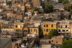 Slum Cairo roofs with satellite dishes. Evening shot of the roofs of slum housing in Cairo bristling with satellite dishes despite the poverty Stock Images