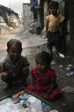Slum Children. Indian Children buying street food and spicy pickles from a roadside seller in Kolkata Stock Photography