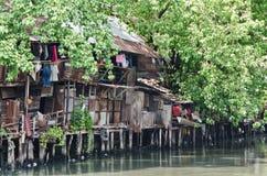 Slum on dirty canal Stock Photos