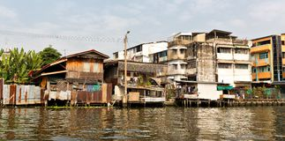 Slum on dirty canal in Thailand Stock Image