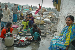 Slum dwellers of Kolkata-India. Kolkata, West Bengal, India - Children and their minders in a slum area. Kolkata, formerly called Calcutta, is the capital of Royalty Free Stock Image