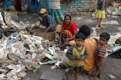 Slum dwellers of Kolkata-India. Kolkata, West Bengal, India - Children and their minders in a slum area. Kolkata, formerly called Calcutta, is the capital of Royalty Free Stock Photography
