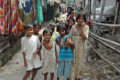 Slum dwellers of Kolkata-India. Kolkata, West Bengal, India - Children and their minders in a slum area. Kolkata, formerly called Calcutta, is the capital of Royalty Free Stock Photo