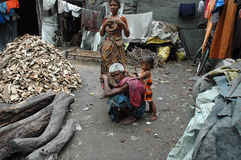 Slum dwellers of Kolkata-India. Kolkata, West Bengal, India - Children and their minders in a slum area. Kolkata, formerly called Calcutta, is the capital of Royalty Free Stock Photos