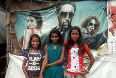 Slum Girls. September 17,2012 Bantala,Kolkata,West Bengal,India,Asia-Slum girls are posing,behind the cinema poster royalty free stock photography