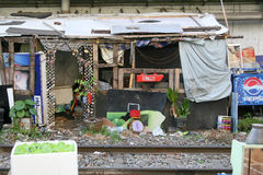 Slum house under the bridge. Plastic home from rubbish. Bangkok, Thailand Royalty Free Stock Photos