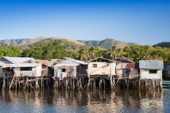 Slum. Houses staying on stilts in the sea stock image