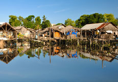 SLUM HOUSES ON WATER Stock Photography