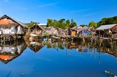 Slum Houses on Water. Poor living area in Puerto Princesa, Philippines stock images