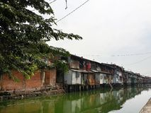 Slum in Jakarta. Rundown houses on the riverbank in Jakarta Royalty Free Stock Photo