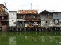 Slum in Jakarta. Rundown houses on the riverbank in Jakarta Royalty Free Stock Photography
