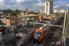 Slum of Moinho. Sao Paulo, Brazil, July 01, 2016. slum of Moinho and railroad of Metropolitan Rail Company, CPTM, acronym in portuguese Royalty Free Stock Photos