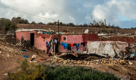 Slum in Morroco. Farmer house with washing in Morocco Royalty Free Stock Photo