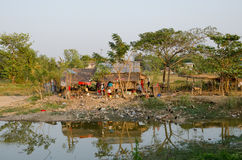Slum Myanmar. Myanmar poor house with a bunch of dirt and debris. Environmental contamination Royalty Free Stock Images