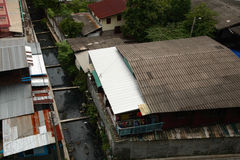 Slum near dirty canal in Bangkok, Thailand Stock Photos