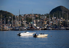 Slum near the sea, with rich boats and yachts Royalty Free Stock Images