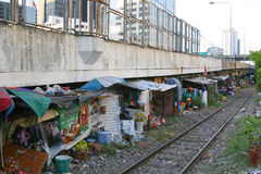 Slum under the bridge. Business-center above and slum under the bridge. Bangkok, Thailand Royalty Free Stock Photos