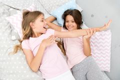 Slumber party concept. Girls just want to have fun. Invite friend for sleepover. Best friends forever. Consider theme stock photos
