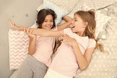 Slumber party concept. Girls just want to have fun. Invite friend for sleepover. Best friends forever. Consider theme stock photography