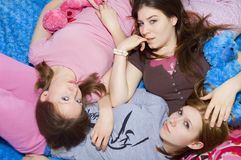Slumber Party Girls. 3 girls laying on each other in their pajamas Royalty Free Stock Photos