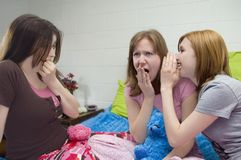 Slumber Party Gossip. Girls gossiping at a slumber party Stock Images